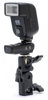 Aputure Trigmaster II receiver mounted on a light stand bracket