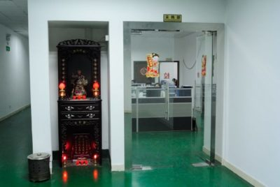 A shrine in the hallway outside the Godox company offices