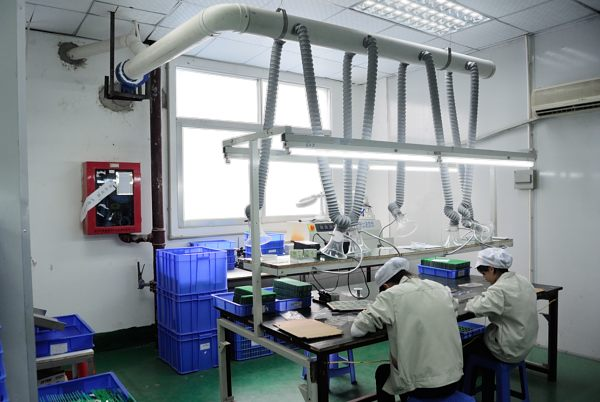 Workers producing electronic components