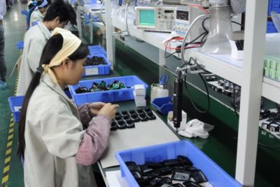 A Godox worker assembling radio flash triggers