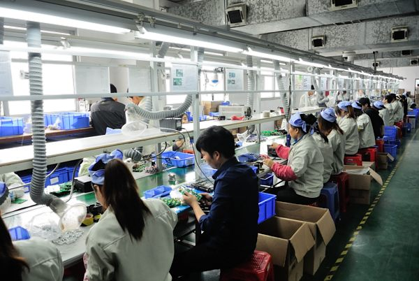 Workers on the Godox production line