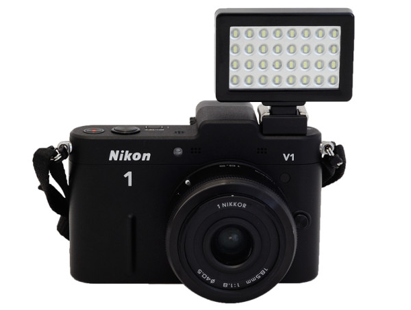 Photojojo Pocket Spotlight mounted on a Nikon 1 V1 camera